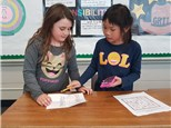 """1st gr students play """"Calcu-Cross-Word©"""", which helps them apply their calculator skills while they learn to        recognize multi-digit numbers!"""