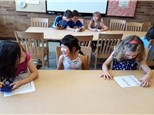 """Students play """"Calcu-Cross-Word""""© in groups, learning about operations and calculator use."""