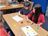 """Students are playing """"Fraction Bingo""""© to solidify their knowledge and use of equivalent fractions."""