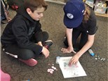 """3rd graders play """"Making Pathways-Multiplication""""©, giving them practice in thinking about what products they need to move across a game board, and picking factors that will result in those products."""