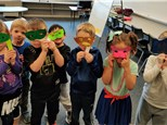 How about decorating your own mask using symmetry, like these 1st graders did! Fun way to learn what symmetry has to do with our faces!