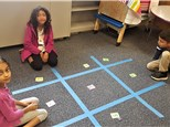 """Students play a giant """"Tic-Facts-Toe""""© this past summer, for lots of addition practice!"""
