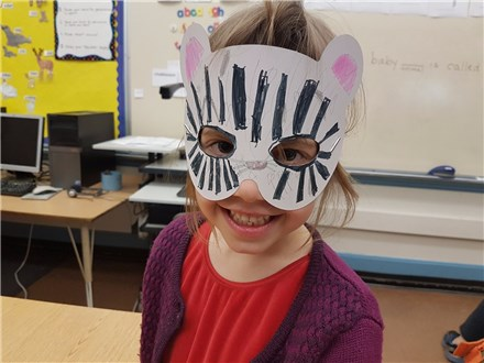 For their math craft, students drew their own masks using symmetrical properties seen in faces of animals!