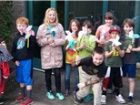"""Students play a different game each week, and they  also work on a """"math craft!"""" These students display  pinwheels they created using symmetrical designs!"""