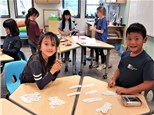 """2nd gr students play """"High-Low Pairs""""© to practice addition and subtraction skills!"""