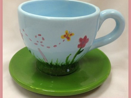 Each party guest will paint a girl sized tea cup and saucer and a doll sized tea cup and saucer!